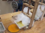Pressing the cheddar curds