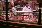 Butchers preparing counter