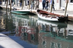 Boats reflecting in canal