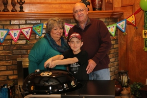 Mama J, Papa J, and Jackson with his Weber Performer